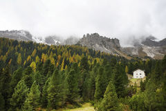 Autumnal landscape with cottages in Dolomites Mountains Royalty Free Stock Photos