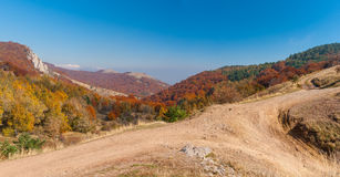 Autumnal landscape with earth road in mountain. Pasture Demerdzhi, Crimean peninsula stock image