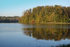 Autumnal landscape with pond Royalty Free Stock Images