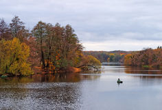 Autumnal landscape with river and fisherman stock photo