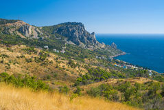 Autumnal landscape with to Blue Bay on a Black Sea shore. Near Simeiz town, Crimean peninsula Stock Images