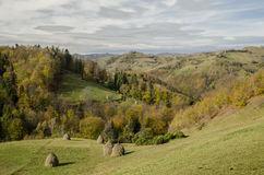 Autumnal landscape of the village hills. Autumnal landscape of the idylic hills in the village Holbav, Brasov County, Romania Stock Photos