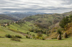 Autumnal landscape of the village hills. Autumnal landscape of the idyllic hills in the village Holbav, Brasov County, Romania Royalty Free Stock Images