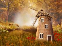 Autumnal landscape with a windmill Stock Photos