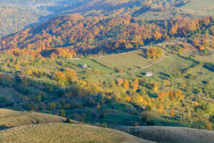 Autumnal mountain landscape with houses. Beautiful sunny autumn Royalty Free Stock Photography