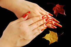 Autumnal nail design. On real nails stock images