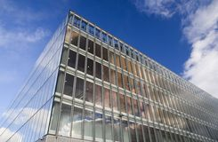 Autumnal offices. Glass faced office building against autumn sky royalty free stock image