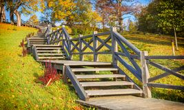 Autumnal old park with wooden stairs Stock Images