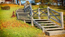 Autumnal old park with wooden stairs Stock Image