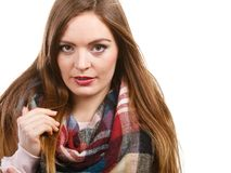 Woman wearing woolen checked scarf warm autumn clothing. Autumnal outfit concept. Young long haired woman wearing warm autumn clothing woolen checked scarf royalty free stock photos
