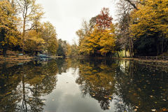 Autumnal pond. A little pond reflecting the trees during the fall season. Monza. Italy stock photo