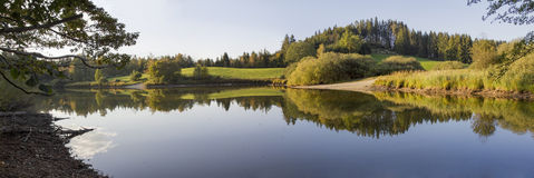 Autumnal pond, tranquil scenery with water reflection Stock Photo