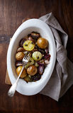 Autumnal potatoes and onions with garlic and green pumpkin seeds Stock Photography