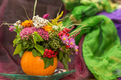 Autumnal pumpkin decoration with flowers Royalty Free Stock Photography