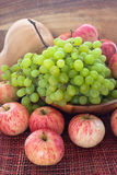 Autumnal ripe fruits and veg - green grape, red apples and pumpk Stock Photography