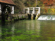 Fall landscape at lake Blautopf with old water mill Royalty Free Stock Photo