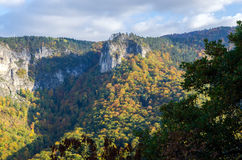 Autumnal scenery of Rodopi mountain, Bulgaria. Sunlit hill and colorful forest at Rodopi mountain, Bulgaria Stock Photography