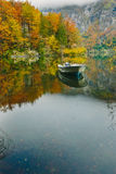 Autumnal scenic view of boats on the Bohinj lake Stock Photo
