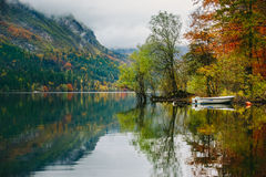 Autumnal scenic view of boats on the Bohinj lake Stock Images