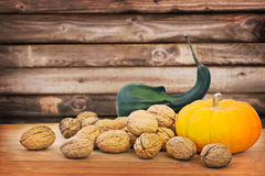 Autumnal still life, walnuts and pumpkin Stock Photo