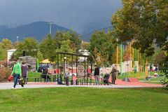 Autumnal Sunday in the playground: parents and children having fun together outdoors. Heidelberg, Germany - October 8 2017. Royalty Free Stock Images