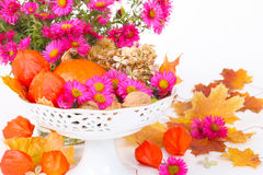 Autumnal table decoration on white. Background Royalty Free Stock Photos