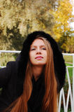 Autumnal Tints. Pretty girl in the park royalty free stock photography