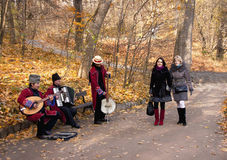 Autumnal view of Sofiivka park with girls and musicians. Stock Photos