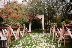 Autumnal wedding archway decoration of roses, apples, grape and pomergranate Stock Photography