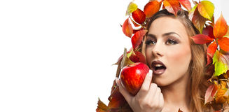 Autumnal woman. Beautiful creative makeup and hair style in fall concept studio shot. Beauty fashion model girl with fall makeup Royalty Free Stock Photography