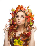 Autumnal woman. Beautiful creative makeup and hair style in fall concept studio shot. Beauty fashion model girl with fall makeup Stock Photos