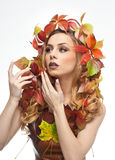 Autumnal woman. Beautiful creative makeup and hair style in fall concept studio shot. Beauty fashion model girl with fall makeup Stock Photo