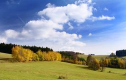Autumny scenery with clouds Stock Images