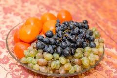 Autunno e frutti esotici Fotografia Stock