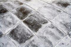 Auvent carré gris de tuile Fond, texture photographie stock