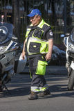 Auxiliary italian municipal police in Rome. An auxiliary of the municipal police in Rome (Italy). He is working with a uniform. Next to him there are two bikes Stock Photos