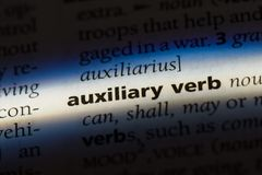 Auxiliaryverb. Auxiliary verb word in a dictionary. auxiliary verb concept Stock Photos