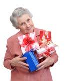Avó com presentes Fotografia de Stock Royalty Free