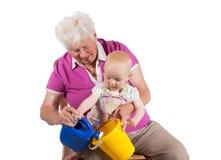 Avó que joga com seu neto Foto de Stock Royalty Free