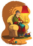 Avó que senta-se na poltrona e na confecção de malhas Fotos de Stock Royalty Free