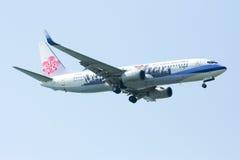 737-800 av det Kina flygbolaget Arkivbild