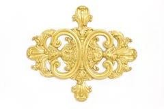 Av en forntida guld- prydnad på en vitbakgrund Arkivbild