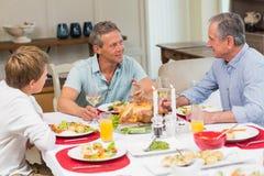 Avô, pai e filho falando junto Imagens de Stock Royalty Free