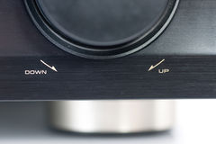 AV Receiver Volume Knob. Closeup of an AV Receiver Volume knob, focus on the text indicating the direction to increase or decrease the volume Royalty Free Stock Image