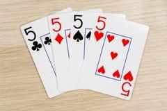 4 av snälla pickolaflöjter 5 - kasino som spelar pokerkort arkivfoto