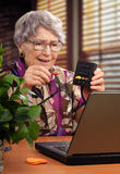 AV splitter-switcher is held by retired woman Stock Photography