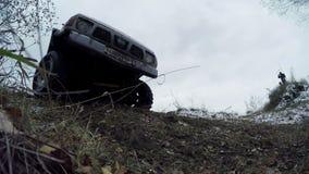 Av-väg bilkörning på en grusväg stock video
