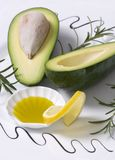 Avacado 2. A sliced avacado with lemon provide a colorful display Stock Photography