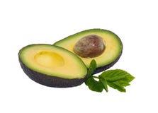 Avacado. Ripe avacado cut in half, with mint Royalty Free Stock Image
