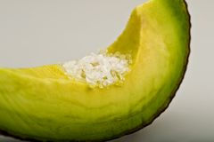 Avacado with sea salt. Image of a slice of Avacado with olive oil and sea salt Stock Photography